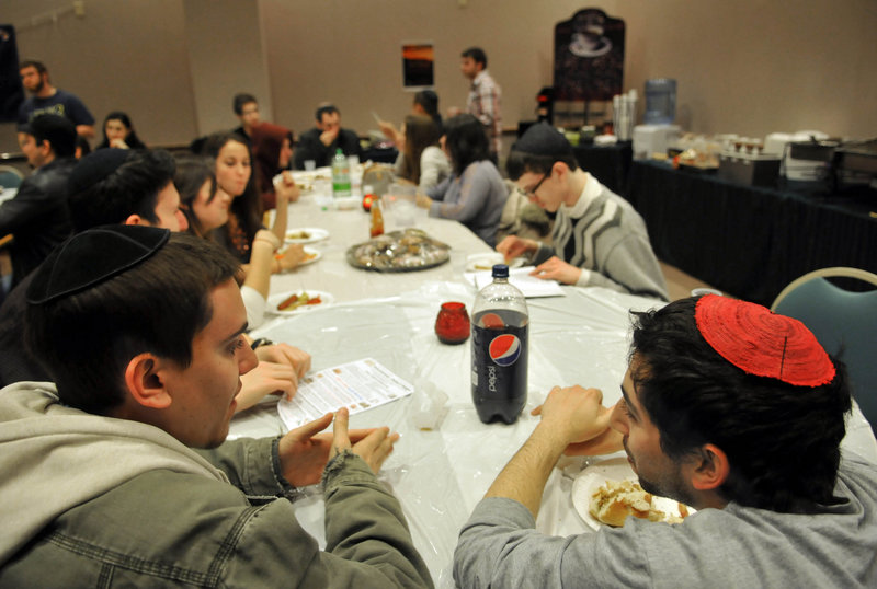 "Students Matt Mantel, left, and Koby Sterman participate in a ""pizza and philosophy"" gathering at Chabad House at Rutgers University in New Brunswick, N.J. The Jewish group has staked out a prominent location."