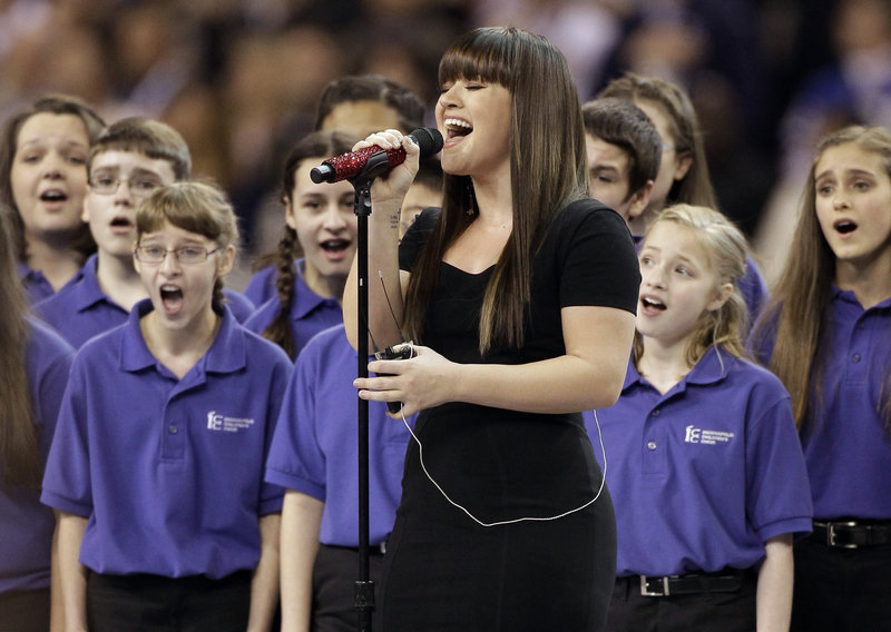 "Kelly Clarkson, shown at the 2012 Super Bowl, said a video of her song ""Stronger"" sung by young cancer patients ""made my day."""