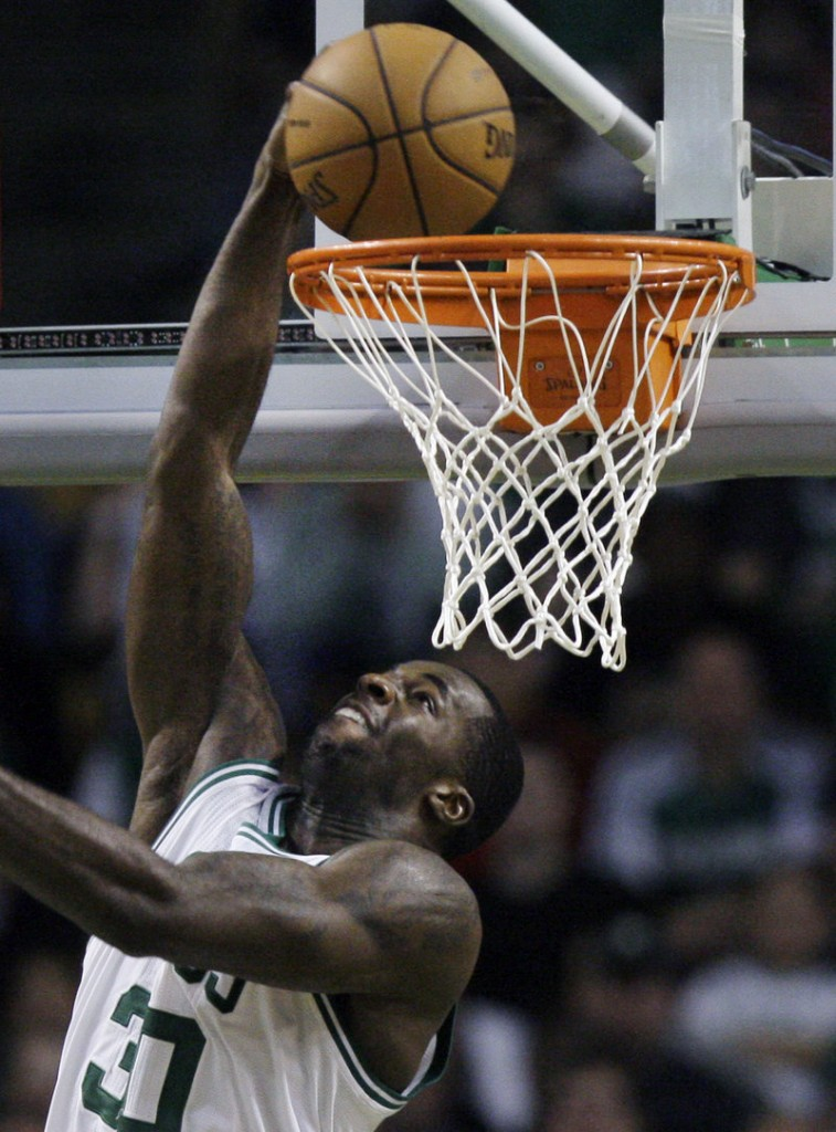 Brandon Bass of the Boston Celtics puts in a reverse layup Saturday night during Game 1 of the Eastern Conference semifinals against the Philadelphia 76ers. Boston won, 92-91.
