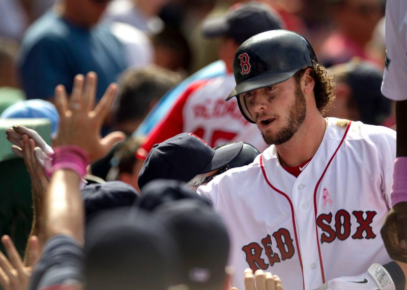Jarrod Saltalamacchia returns to the Boston dugout after hitting a two-run homer in Sunday's game at Boston. Saltalamacchia had five RBI in the 12-1 win.