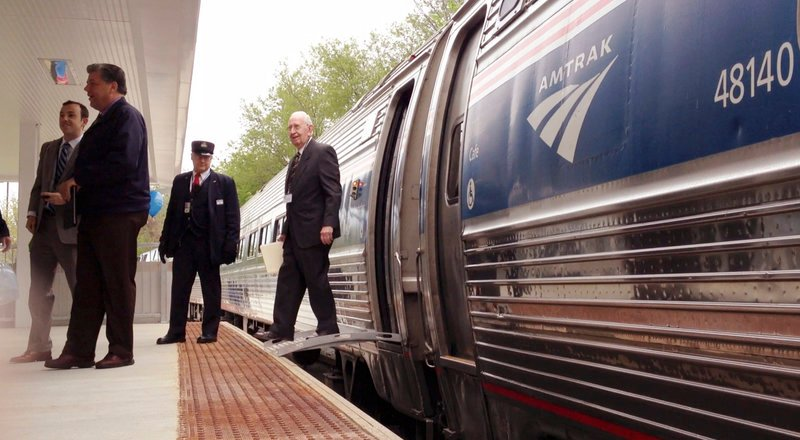 Ed Bonney, chairman of the Freeport Train Committee, steps off the Downeaster at the station in Freeport on Monday.