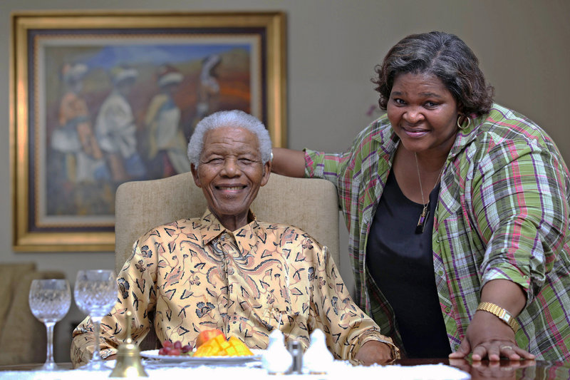 Nelson Mandela, left, the former president of South Africa, spends time with his personal chef, Xoliswa Ndoyiya. The chef is sharing the home cooking that Mandela loves in a new cookbook.