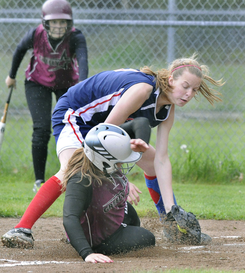 Lindsey Arsenault of Greely scores the game's first run as Gray-New Gloucester pitcher Stephanie Greaton covers the plate during Greely's 9-3 win Monday.