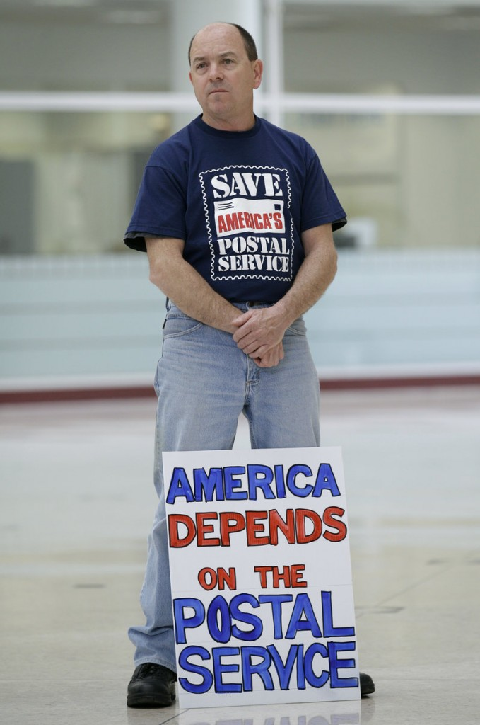 Postal worker Dan Duff of Des Moines, Iowa, attends a rally there Monday.