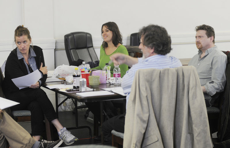 Moira Driscoll, left, Tess Van Horn, director Andrew Harris and Mark Honan dissect and discuss during rehearsal.