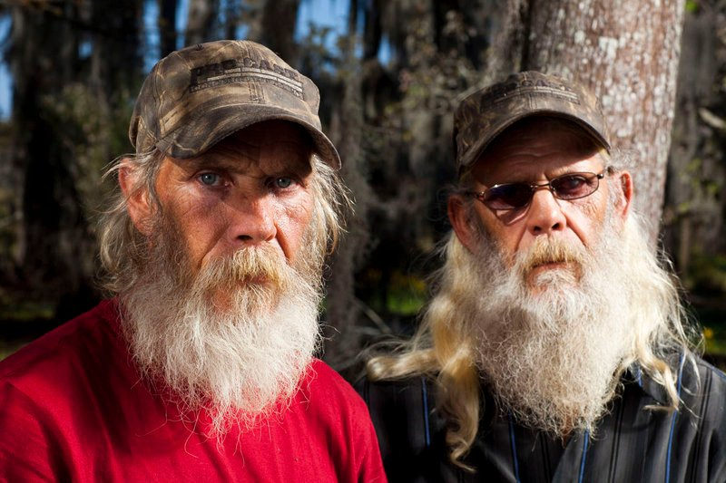 """Mitchell Guist, left, and his brother Glenn, from the series """"Swamp People"""" in a photo from History. Mitchell Guist died Monday after falling on his boat."""