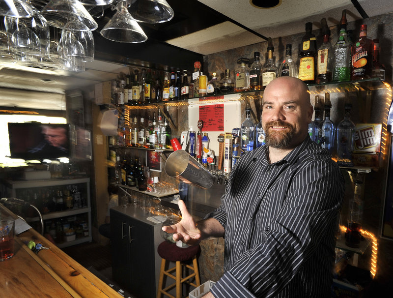 Bartender Scott Maher works at Spring Point Tavern in South Portland, which draws a diverse crowd and hosts trivia, water pong, karaoke and live bands.