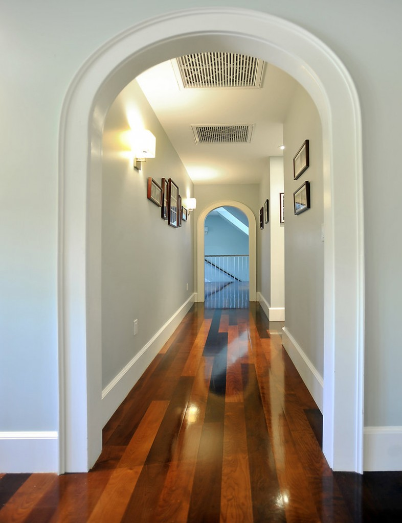 An upstairs hallway connecting bedrooms on either side of the house.
