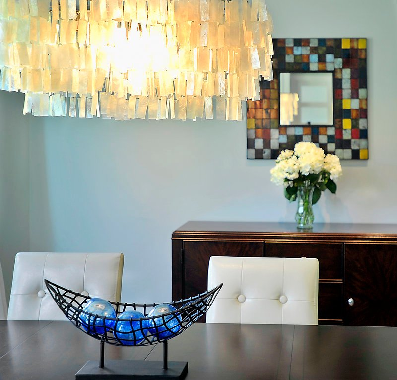 Another lighting choice adds dazzle to the decor of the contemporary-style formal dining room.