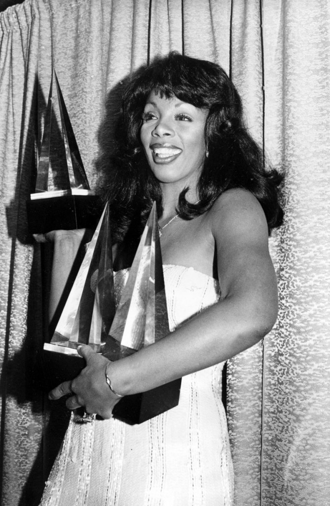 Summer poses with three awards she won at the American Music Awards in Los Angeles, Calif., on Jan. 12, 1979.