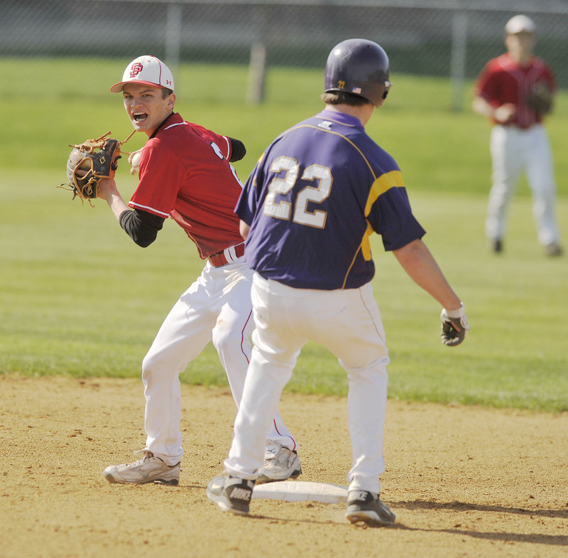 South Portland shortstop Dominic Desjardins tries to complete a double play after forcing out Ryan Casale during Cheverus' 9-4 victory Thursday.