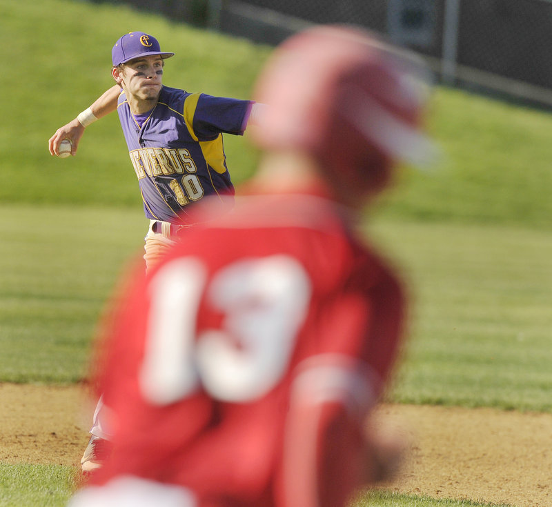 Second baseman Nick Melville of Cheverus throws out Shawn Shannon of South Portland after fielding a gounder in the sixth inning Thursday. Cheverus won, 9-4.