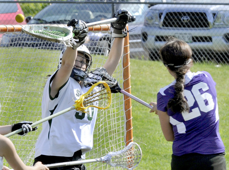 Anastasia Muca of Deering finds room to get the ball past goalie Alicia Hoyt of Bonny Eagle to score a goal Thursday during their schoolgirl lacrosse game. Hoyt made 15 saves in Bonny Eagle's 16-7 victory.