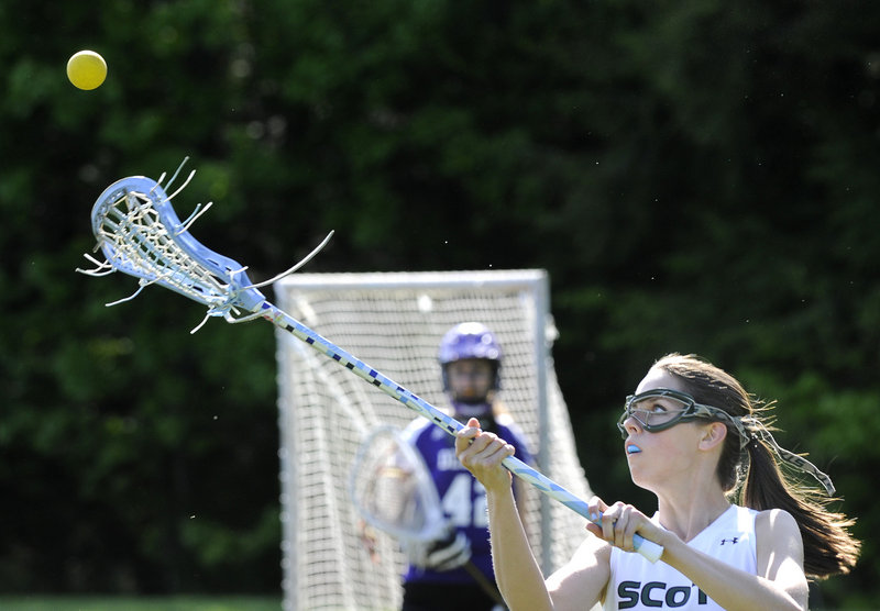 Jess Warren of Bonny Eagle catches a pass Thursday in a girls' lacrosse match against Deering. Bonny Eagle won, 16-7.