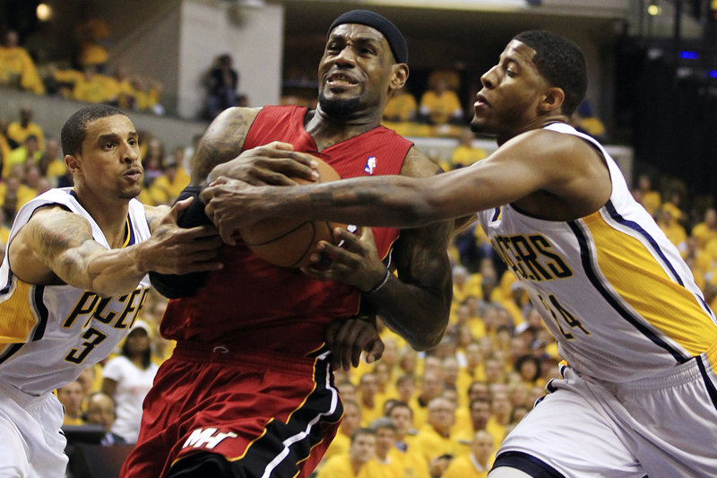 LeBron James of the Miami Heat heads to the basket Thursday night against George Hill, left, and Paul George of the Pacers. Indiana won 94-75 and has a 2-1 series lead.