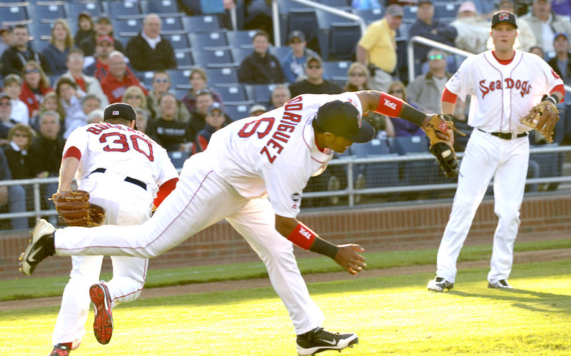 Sea Dogs first baseman Reynaldo Rodriguez barely avoids pitcher Billy Buckner as he catches a popup Friday against the Binghamton Mets. Rodriguez later hit an RBI triple to help Portland to a 4-0 win.