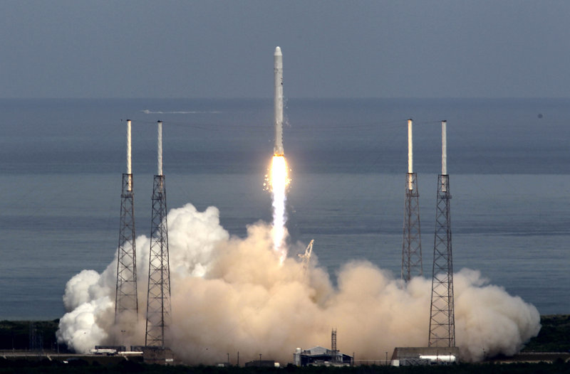 In photo from June 4, 2010, the SpaceX Falcon 9 test rocket lifts off from Cape Canaveral, Fla., carrying a mock-up of the private company's Dragon spacecraft atop the rocket.