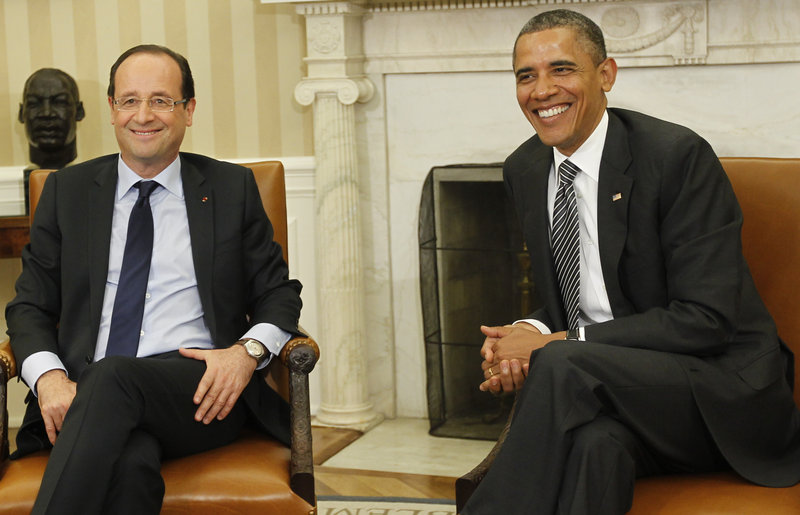President Obama meets with newly elected French President Francois Hollande on Friday in the Oval Office of the White House in Washington.