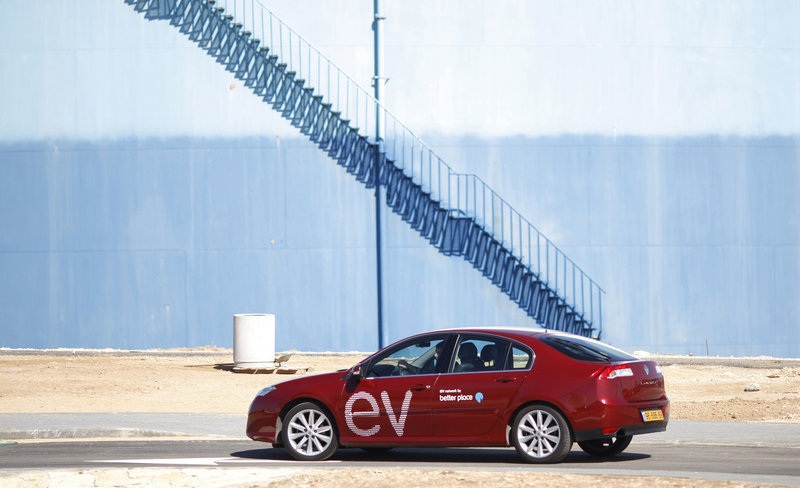 An electric car is seen at a demonstration by the company Better Place in Tel Aviv, Israel. Renault is selling a sedan that is customized to use Better Place's network of battery stations.