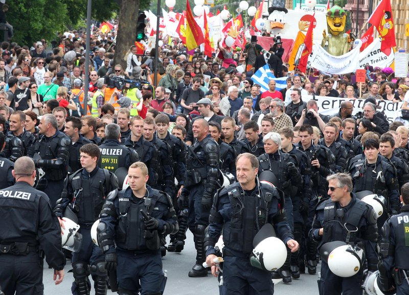 German police escort marchers Saturday in Frankfurt. Protesters filled the city center to protest the dominance of banks and what they perceive to be untamed capitalism.
