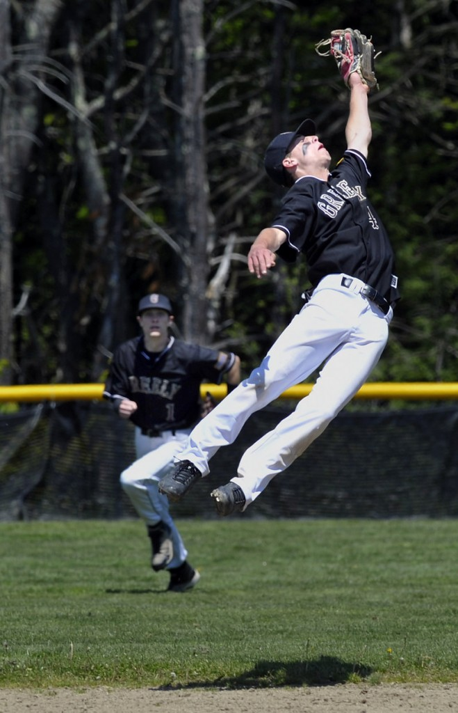 Second baseman Will McAdoo of Greely leaps to snare a potential run-scoring single as center fielder Jimmy Whitaker moves in against Falmouth.