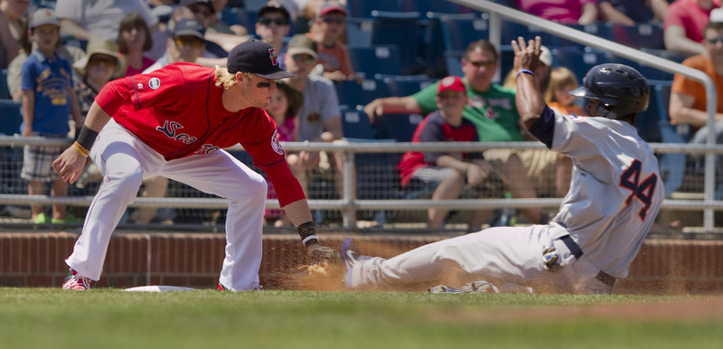 Sea Dogs third baseman Kolbrin Vitek tags out Binghamton's Raul Reyes on a stolen-base attempt Sunday during Portland's 11-7 loss at Hadlock Field.