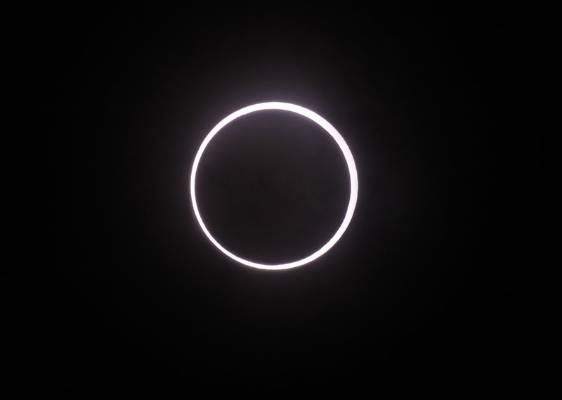 An annular solar eclipse is seen over Yokohama, Japan, near Tokyo, early today.