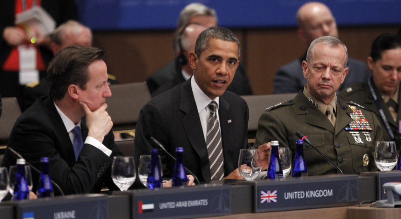 President Obama speaks Monday at a NATO summit in Chicago, as British Prime Minister David Cameron, left, and Gen. John Allen, commander of U.S. and NATO forces in Afghanistan, listen.