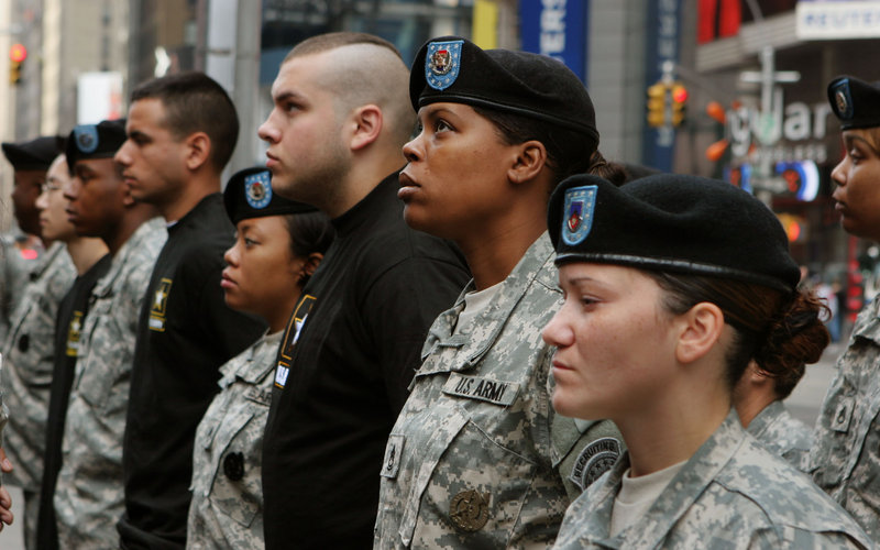 Newly enlisted Army recruits, in black shirts, join recruiting officers in a ceremony in New York in 2006.