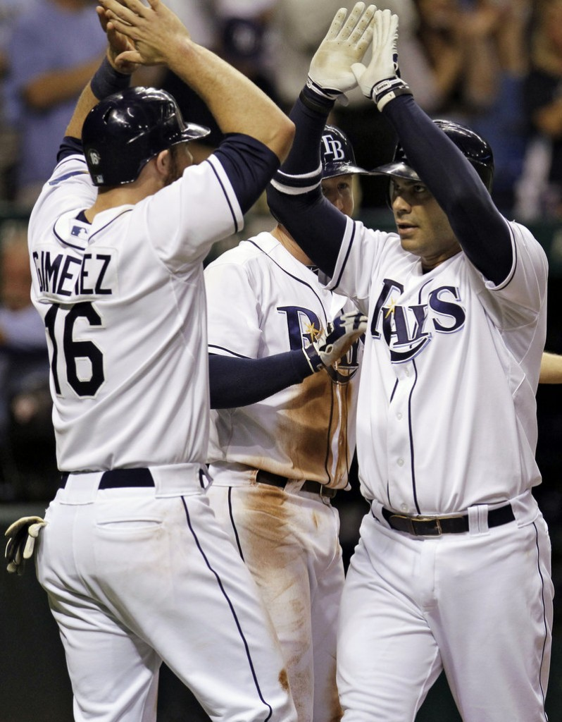 Carlos Pena, right, celebrates his three-run homer with Chris Gimenez in the fourth inning Tuesday in Tampa Bay's 8-5 win over visiting Toronto.