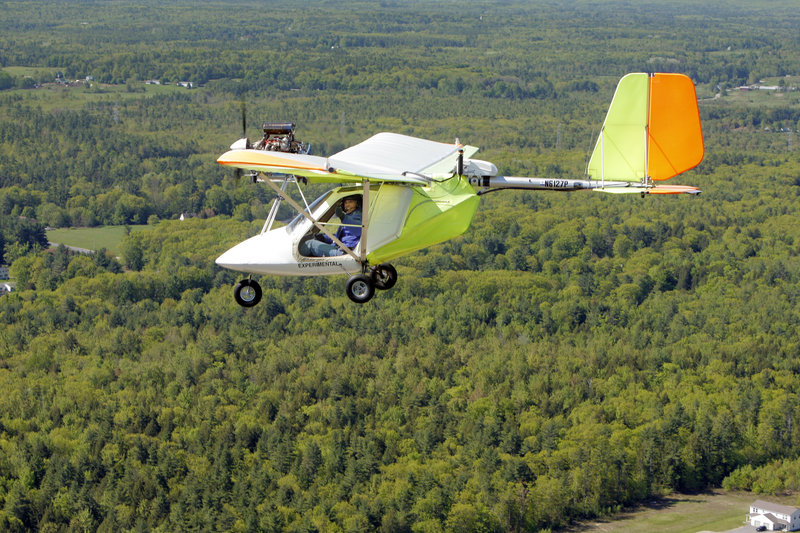 """Shawn Moody flies an experimental aircraft over Gorham . """"Everything looks so different from the air,"""" says Moody, who's been flying for 20 years. """"You really see it for what it is."""""""