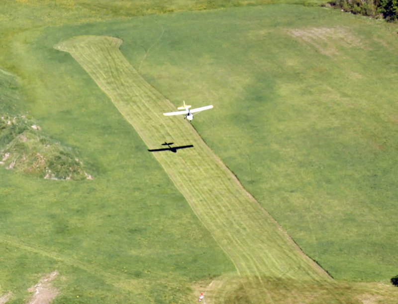 """Shawn Moody lands an experimental aircraft on a grass strip at his friend and fellow pilot John Pompeo's home in Buxton. Moody says he finds his pastime to be relaxing: """"You're so focused on flying, you kind of forget about everything else."""""""