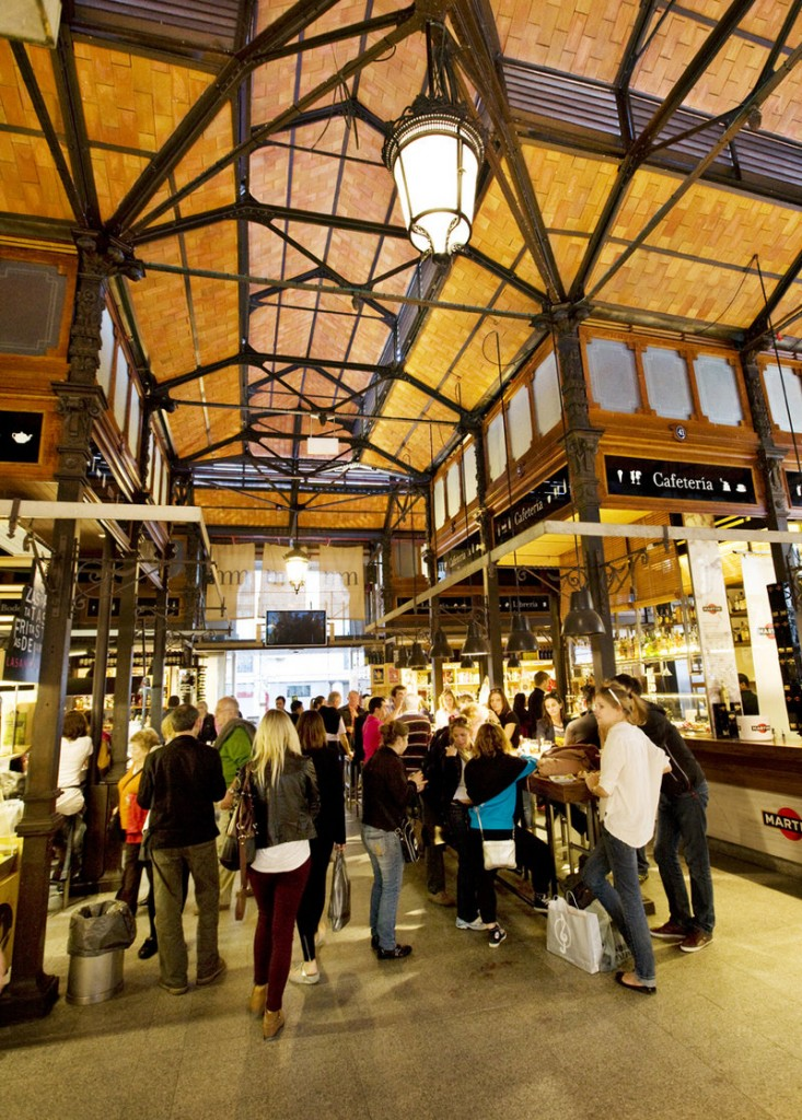 The Mercado de San Miguel in Madrid, a market where locals and tourists mingle happily.