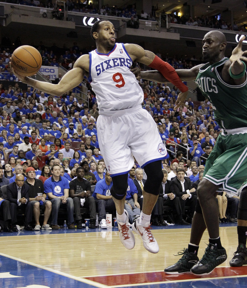 Andre Iguodala of the Philadelphia 76ers tries to pass while guarded by Kevin Garnett of the Celtics in the Sixers' 82-75 victory Wednesday in Game 6.
