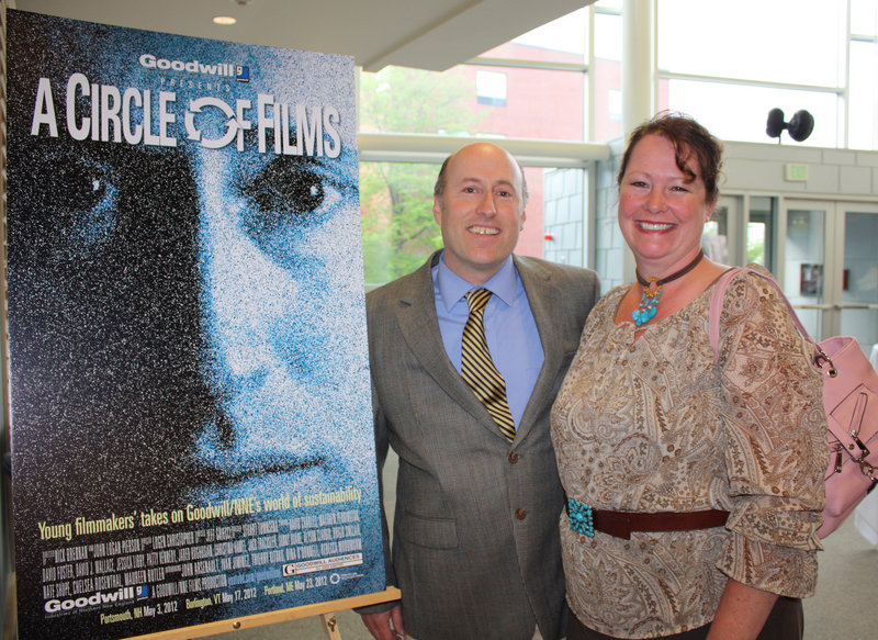 Actors David Wallace of Brunswick and Patty Kennedy of Freeport, next to the poster for the film
