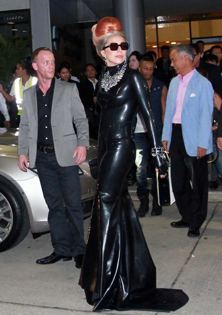 Lady Gaga pauses while making her way to a waiting car upon her arrival at Don Muang airport in Bangkok, Thailand, on Wednesday.