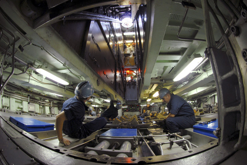 A weapons team prepares to receive a torpedo aboard the USS Albany, a Los Angeles-class attack submarine like the USS Miami that caught fire at the Portsmouth Naval Shipyard. The USS Albany was recently in for maintenance at Newport News Shipbuilding in Virginia.