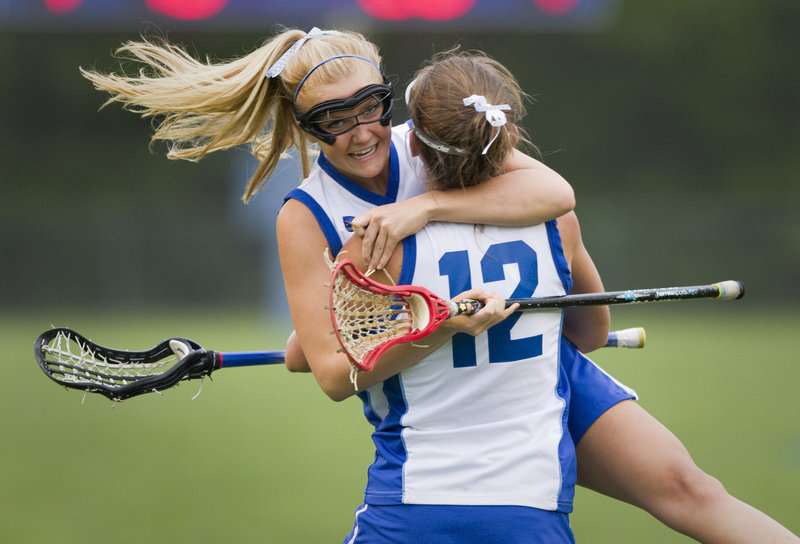 Alyssa Fallon of Kennebunk joyfully congratulates teammate Kate Graydon after Graydon tied the game against Scarborough at 5-5 on Thursday night. Kennebunk tied the game three times against the top-ranked Red Storm before suffering a 9-8 setback.