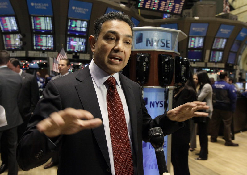 Sanjay Jha, chairman and CEO of Motorola Mobility, is interviewed on the floor of the New York Stock Exchange last year. He was paid $47.2 million in 2011.