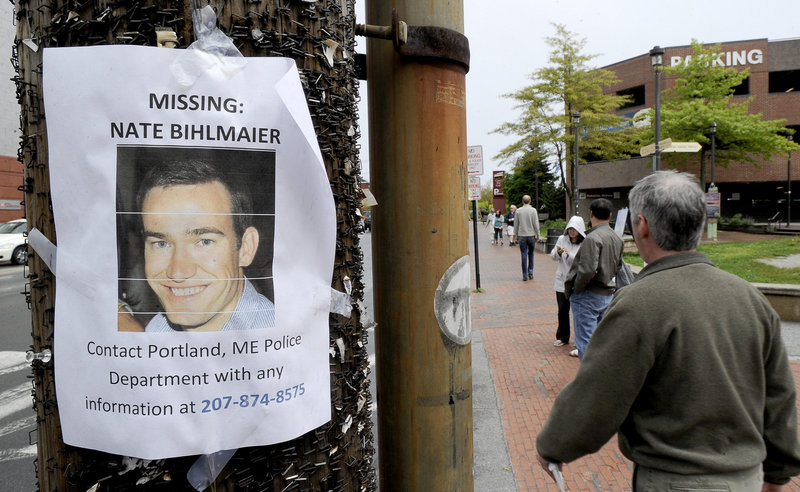 A flier alerting the public to the disappearance of Nathan Bihlmaier is posted on Portland's waterfront last Tuesday. His body was found last Wednesday.