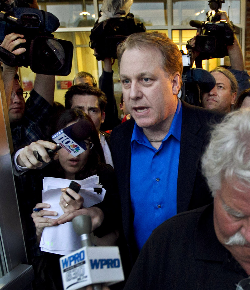 Former Boston Red Sox pitcher Curt Schilling leaves a meeting with the R.I. economic development agency that's in hot water over backing a $75 million loan to his company in 2010.