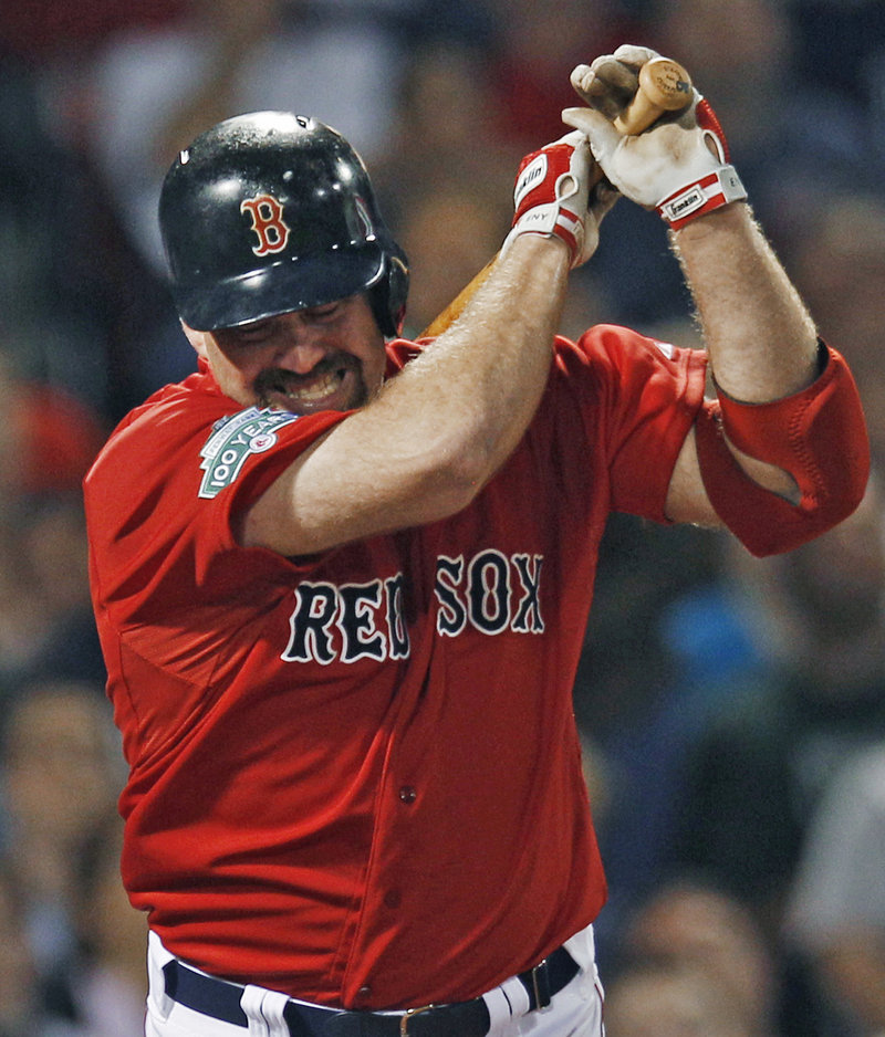 The windup before the toss as Kevin Youkilis prepares to throw his bat after grounding out in the seventh inning.