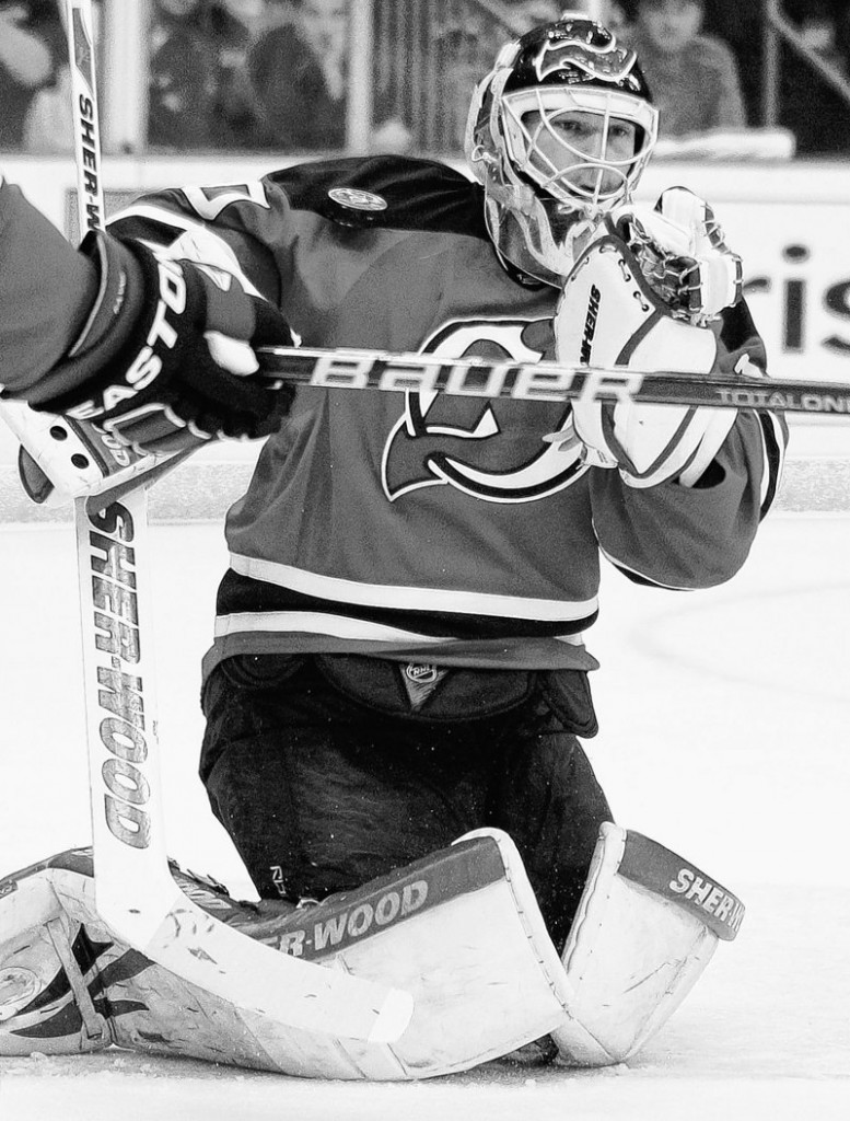 Martin Brodeur of the Devils blocks a shot with his shoulder during New Jersey's 3-2 overtime win over the New York Rangers on Friday to earn a trip to the Stanley Cup.