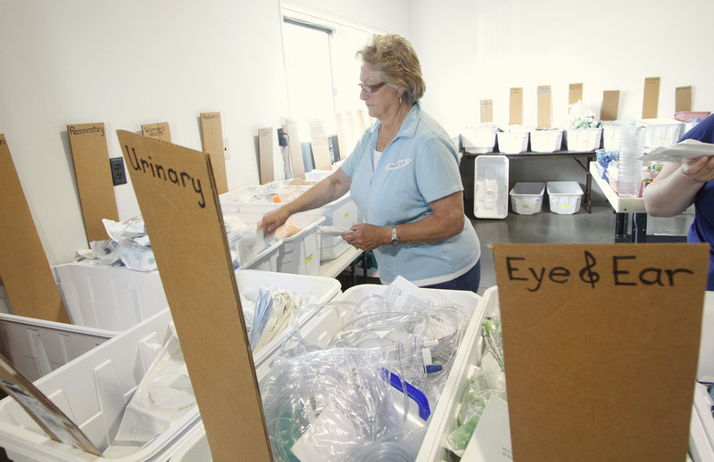 Volunteer Angela LeBlanc of Kennebunk sorts medical supplies that were brought in during a Partners for World Health drop-off day in Scarborough on Saturday.