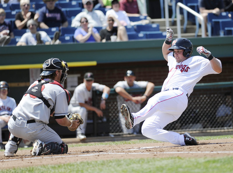 Chris Herrmann of New Britain blocks the plate as Portland's Juan Carlos Linares attempts to score Sunday. Linares was out on the play, but the Sea Dogs won the game, 8-5.