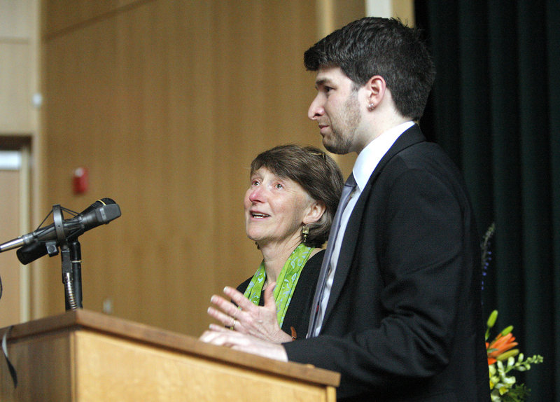 Michael Macklin's wife, Donna Pendleton, and his son Gabe Faulkner-Macklin thank those who attended a memorial service for Macklin at Waynflete School in Portland on Friday. Franklin Theater, which Macklin helped to build, was overflowing with more than 500 people.