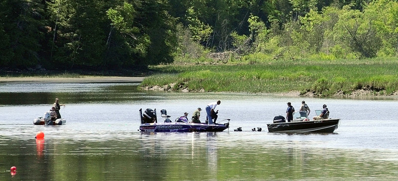 Divers in the water talk to other searchers on boats Sunday morning on the Cathance River in Bowdoinham as they try to find Santana Dubon, 32, of Portland.