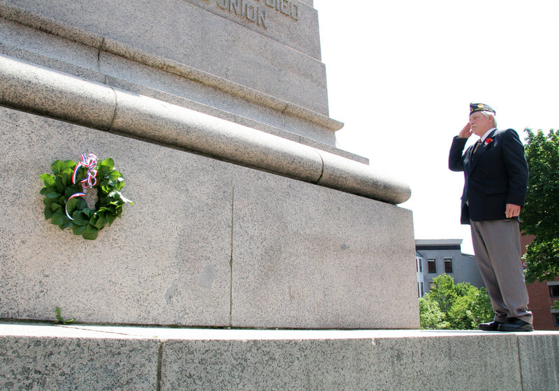 Curtis Ballantine, commander of Portland American Legion Harold T. Andrews Post 17, salutes after laying a wreath at Monument Square during Memorial Day events in Portland. Hundreds of people lined the parade route, and many stayed for the wreath-laying ceremony.