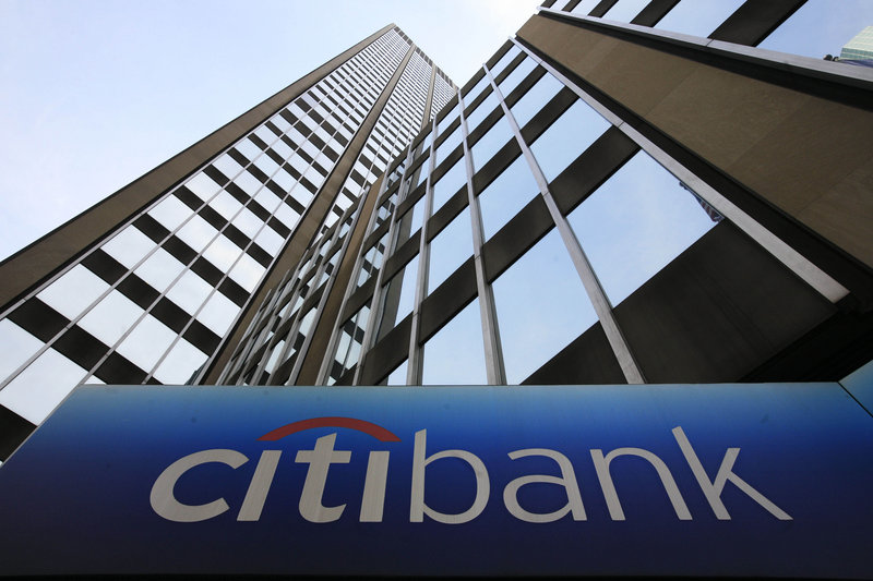 "A sign for Citibank is seen at Citigroup headquarters in New York. Citigroup's acquisition of Salomon Smith Barney in 1998 is one of the events that marked the entry of banks into risky ventures ""to aggrandize more power and assumed prestige for CEOs and shareholders,"" a reader says."