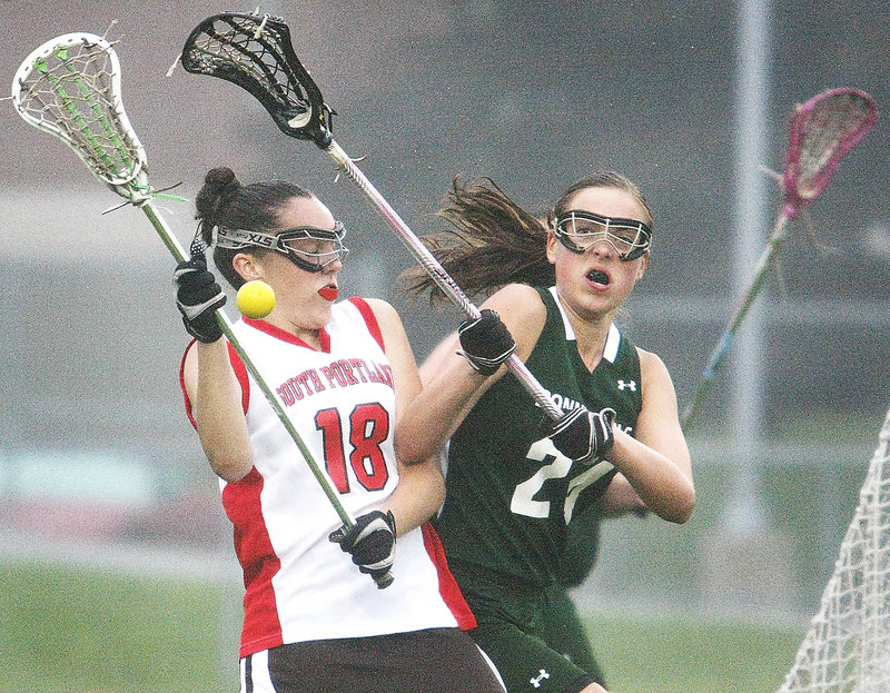 Jackie Merrill of South Portland, left, and Shannon Sanborn of Bonny Eagle compete for possession Tuesday during the first half of their schoolgirl lacrosse game. South Portland earned a 10-7 victory at home.